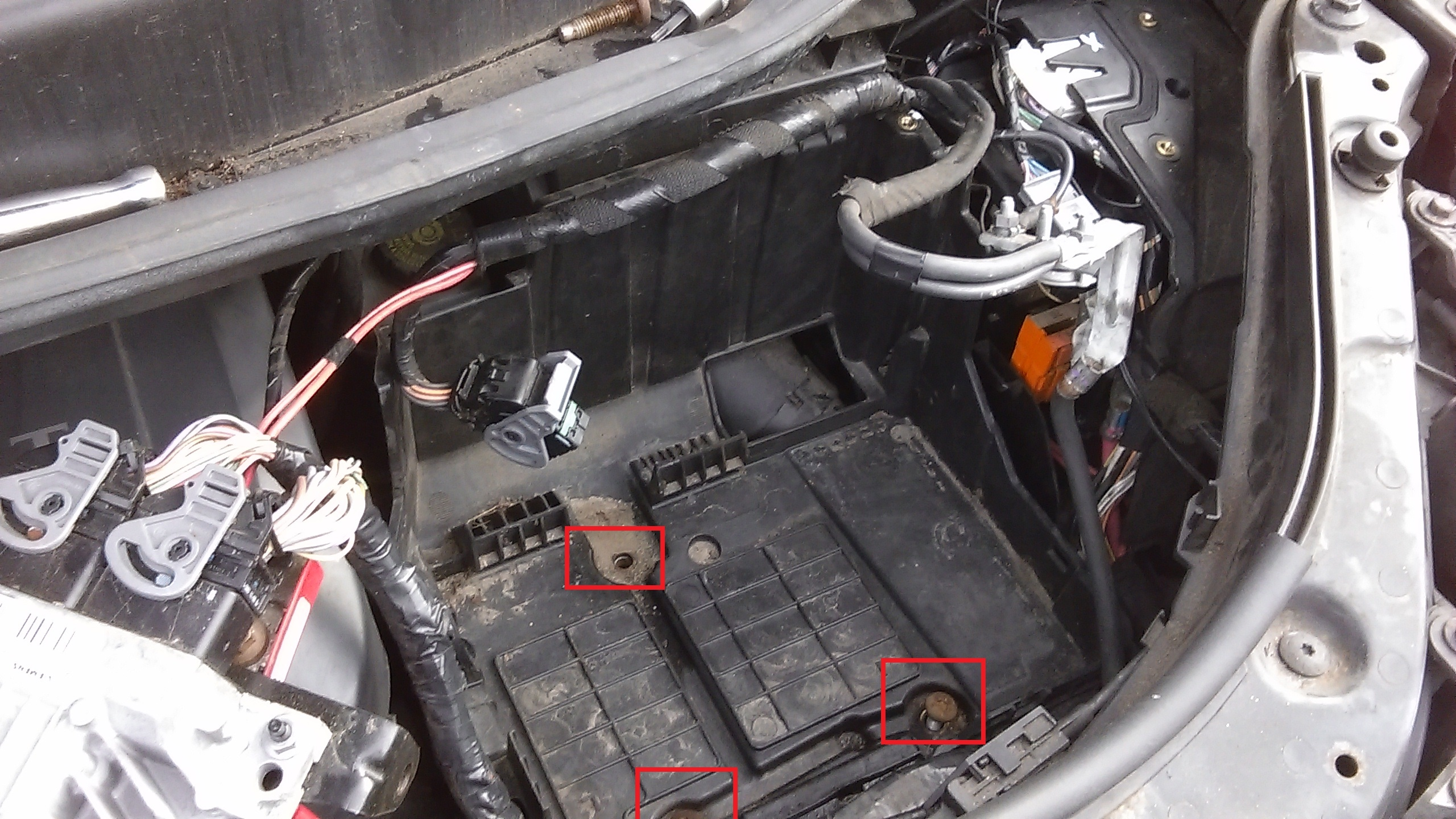 The fuse box will now carefully pull out into the battery tray space.  Unclip the connectors on top. You'll need to undo the bolt holding the  three live feed ...